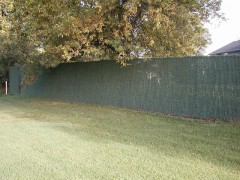 Black Vinyl Coated Chain Link Fence w/ Hedge Lock