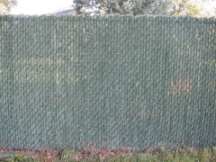 Black Vinyl Coated Chain Link Fence w/ Hedge Lock Slats