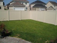Tan Tongue and Groove Vinyl Fence